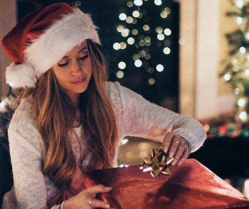 woman wrapping a christmas present